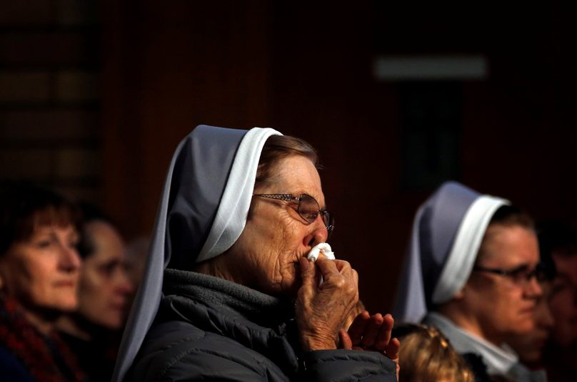 A nun and member of the Australian Ukrainian community cries during a July 2014 prayer vigil for those killed in the crash of Malaysia Airlines Flight MH17. Photo: CNS/David Gray, Reuters