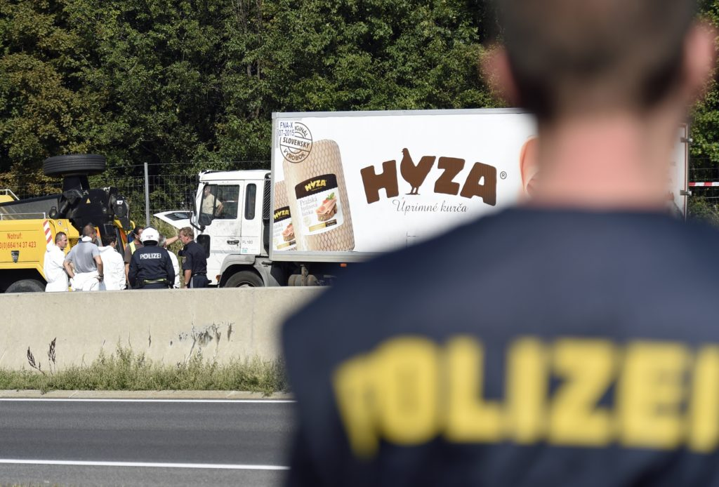 Forensic experts investigate a truck in which refugees were found dead on a freeway between Parndorf and Neusiedl, Austria. Photo: CNS/Herbert P. Oczeret