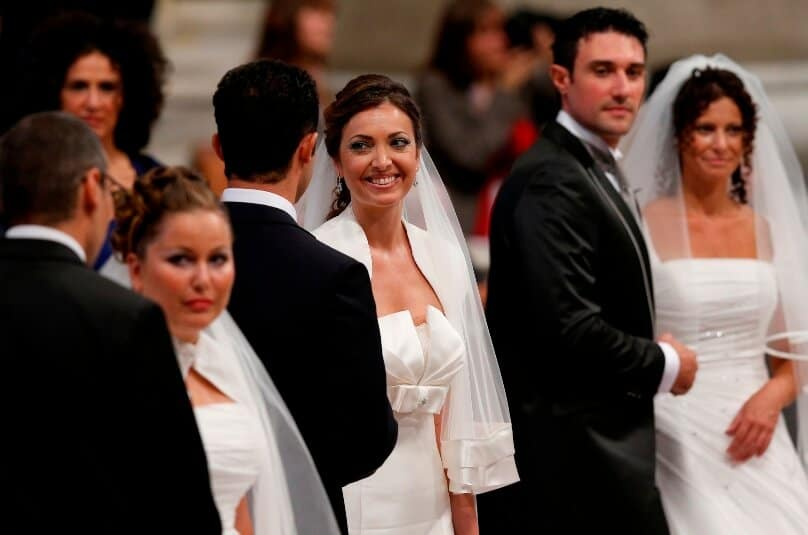 Newly married couples after exchanging vows in St Peter's Basilica at the Vatican in 2014. Photo: CNS/Paul Haring