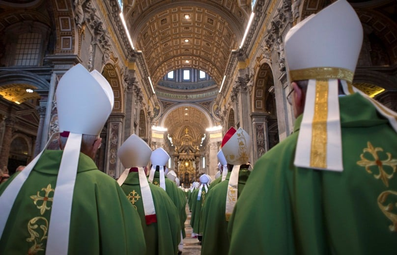 Bishops arrive in procession for the opening Mass of the Synod of Bishops on the family in St Peter's Basilica at the Vatican. Photo: CNS/L'Osservatore Romano, handout