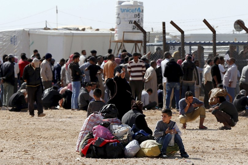 Syrians refugees at the Zaatari refugee camp on 1 November wait to register their names to return to their homeland in Syria. The U.N. refugee agency reports that currently about 100 Syrians return home nearly every day from Jordan. Photo: CNS/Muhammad Hamed, Reuters