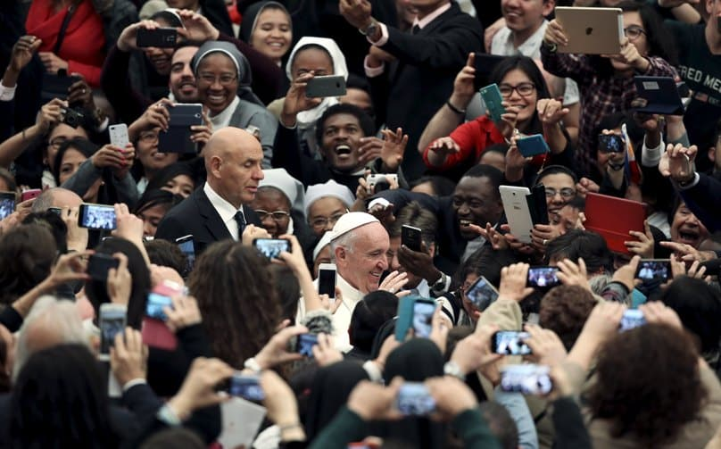 People take photos as Pope Francis arrives to lead a 21 November audience for participants in a world congress sponsored by the Congregation for Catholic Education in the Paul VI hall at the Vatican. Photo: CNS/Stefano Rellandini, Reuters