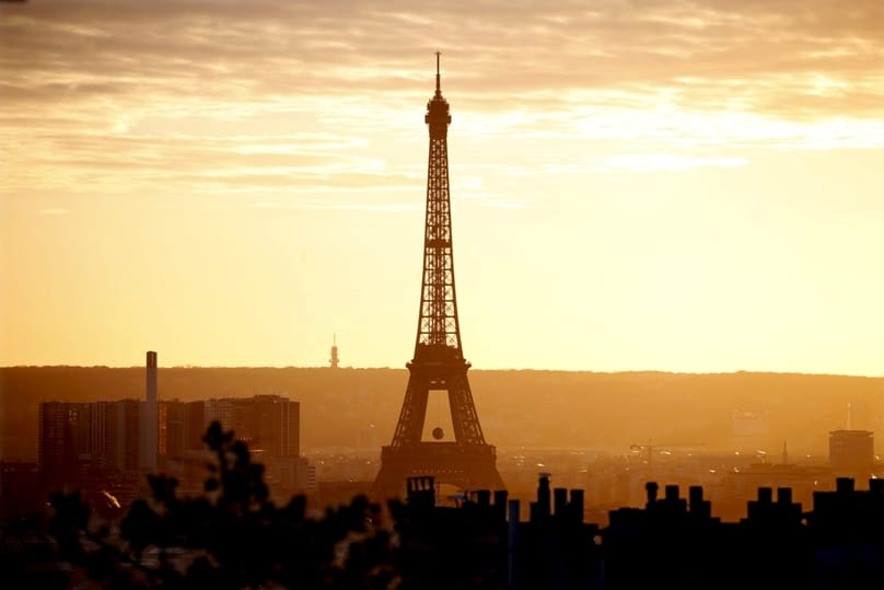 The Eiffel Tower is seen at sunset in Paris on 22 November. Catholic organizations said the terror attacks in Paris had not dissuaded them from attending the U.N. climate change conference in early December. Photo: CNS/Charles Platiau, Reuters