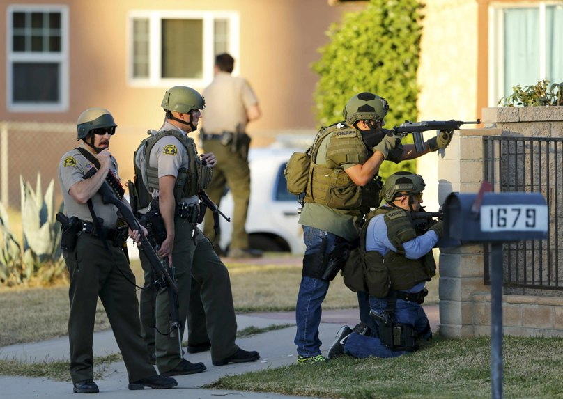 Police officers conduct a manhunt after a mass shooting at the Inland Regional Centre in San Bernardino, California. Photo: CNS/Mike Blake, Reuters