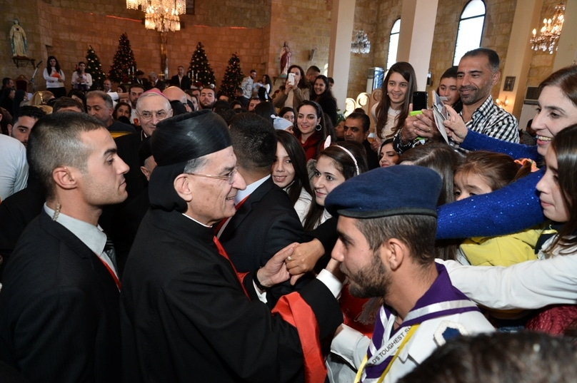 Lebanese Cardinal Bechara Rai, patriarch of the Maronite Catholic Church, greets people after celebrating Mass at Our Lady of the Annunciation Cathedral in Tartus, Syria, on 7 December. Photo: CNS/Mychel Akl for Bkerke, Maronite patriarchate
