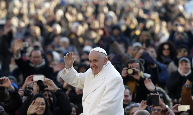 Pope Francis waves as he arrives to lead his weekly audience in St Peter's Square at the Vatican on 30 December. Photo: CNS/Max Rossi, Reuters