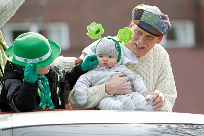 An infant rides atop a pickup truck during a St Patrick's Day Parade held on 5 March in Kings Park, N.Y. In January organisers of the Sydney St Patrick's Day Parade announced the 2016 event was cancelled. Photo: CNS/Gregory A. Shemitz