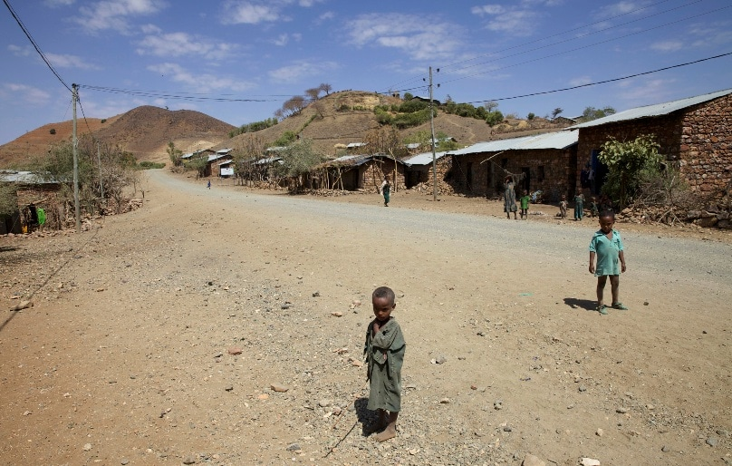 Children stand along a road in the Amhara region of Ethiopia. Photo: CNS/Katy Migiro, Reuters