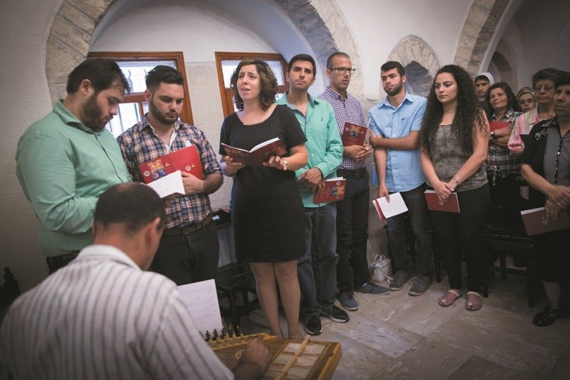 People pray during the 13th Extraordinary Prayer of all Churches for Reconciliation, Unity and Peace at the Maronite patriarchal exarchate church on 19 June in Jerusalem.  Photo: Miriam Alster, CNS