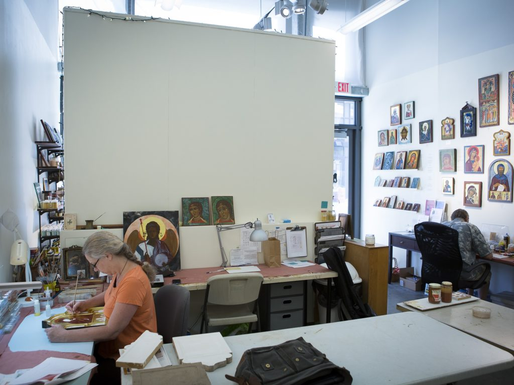 Colette Kalvesmaki works on an icon in her art studio in Washington. Photo: CNS/Tyler Orsburn