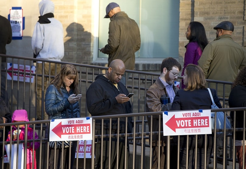 Voters wait in line outside St. Francis Hall in Washington on 8 November. Photo: CNS