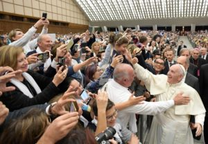 Pope Francis greets the crowd in Paul VI Hall at the Vatican on 26 November 2016. Photo: CNS