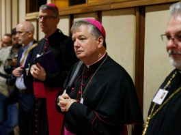 Archbishop Anthony Fisher OP prays at Youth Synod