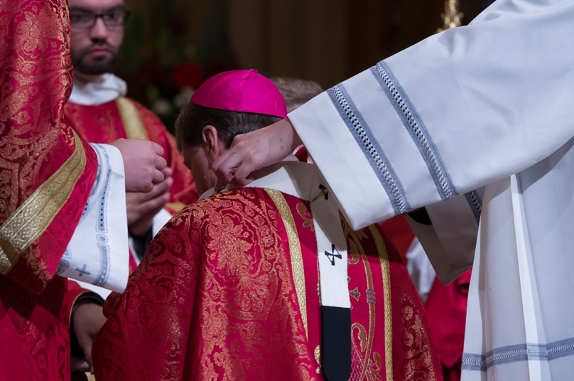 Archbishop Anthony Fisher OP receives the pallium from the Apostolic Nuncio to Australia, Archbishop Adolfo Tito Yllana, at St Mary's Cathedral on July 25. Photo: Giovanni Portelli