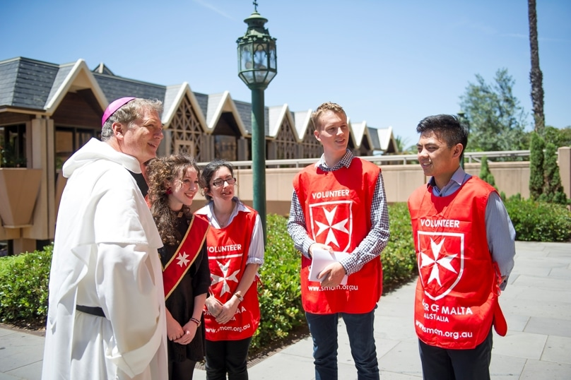 Archbishop Fisher OP met members of the Young Order of Malta at the annual Lourdes Day Mass at St Mary's Cathedral, one of his first cathedral Masses since being installed. Photo: Giovanni Portelli