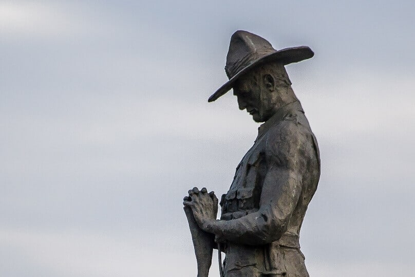 The statue of an Australian Digger stands guard at Anzac Bridge. Photo: Giovanni Portelli