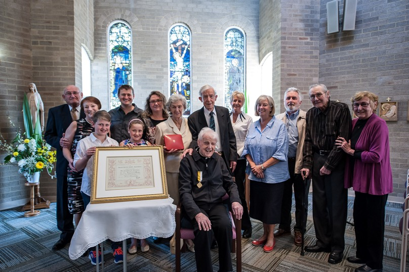 Family and friends gather to celebrate Fr Frank Martin. Photo: Giovanni Portelli