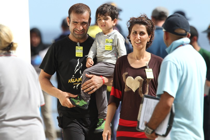 An Afghani family seeking asylum in are processed by Australian Customs and Department of Immigration and Citizenship after their arrival at Flying Fish Cove, Christmas Island, in April 2013. Photo: Wolter Peeters,  The Sydney Morning Herald