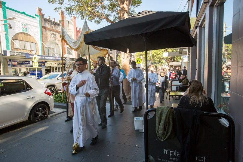 Parishioners proceed through Surry Hills on 29 May to mark the feast of Corpus Christi. Photo: Patrick J Lee