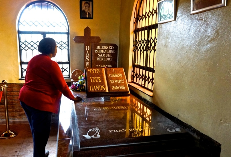 A woman prays inside the church where Blessed Benedict' Daswa's remains now repose. Photo: Jessica Braithwaite