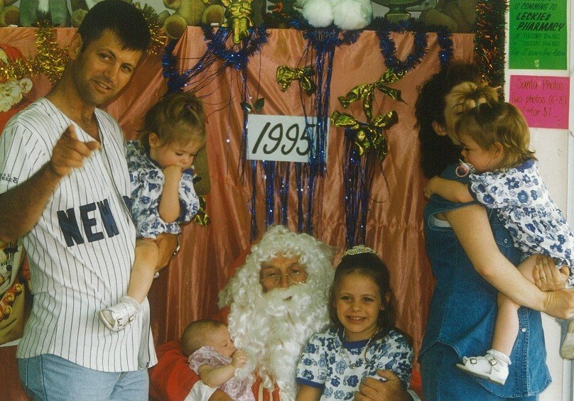 Santa photos ranged from festive to fraught over the years. Photo: Supplied