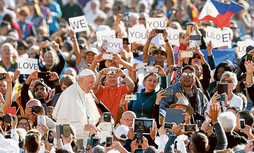 Signs expressing love for Pope Francis are seen as he greets the crowd during his general audience on 10  October in St. Peter's Square at the Vatican. Photo: CNS photo/Paul Haring