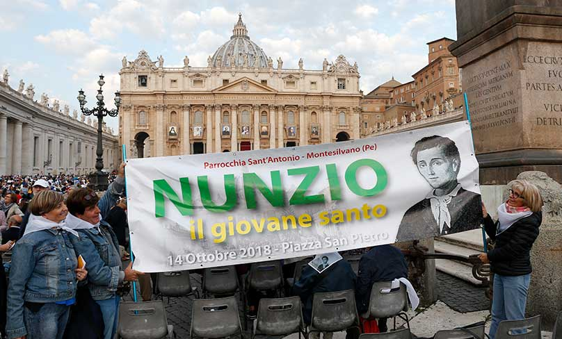 Women hold a banner with an image of new St. Nunzio Sulprizio during the canonization Mass for seven new saints celebrated by Pope Francis on 14 October in St. Peter's Square at the Vatican. Photo: CNS photo/Paul Haring