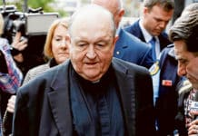 Archbishop Philip Wilson of Adelaide leaves the Newcastle Court on 3 July.