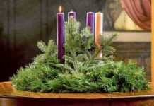 A lit candle is seen on an Advent wreath. Photo: CNS/Lisa Johnston, St Louis Review