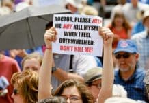 A woman holds up a sign during a rally against assisted suicide in Ottawa, Ontario. Photo: CNS