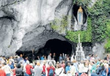 Pilgrims visit the grotto where Mary appeared in Lourdes, France.Main Photo: CNS/Jose Navarro, EPA