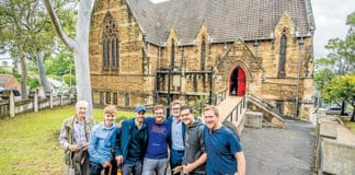 Ronan Reilly, second from right, and fellow walkers set out from St Thomas of Canterbury Church. Photo: Giovanni Portelli