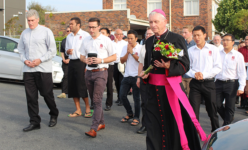 Bishop Patrick Dunn of Auckland carries flowers to place at Al-Jamie Mosque to memorialise victims of the March 15 mosque attacks in Christchurch. Photo: CNS photo/Michael Otto, NZ Catholic