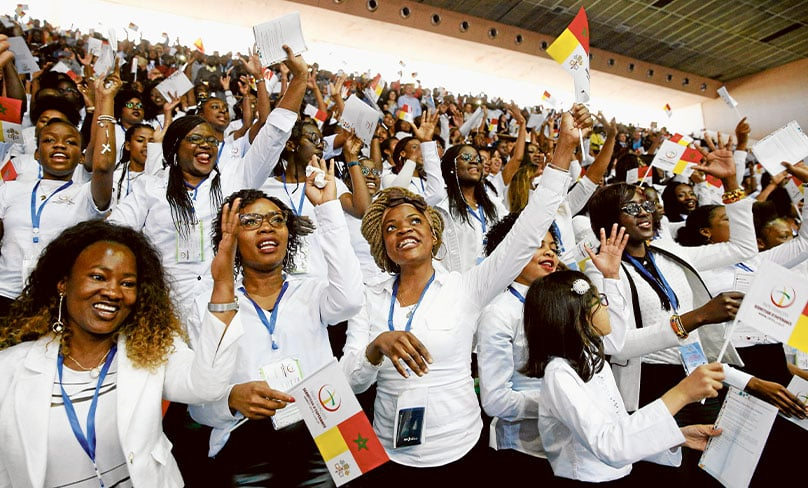 Choir members sing and wave flags as Pope Francis arrives to celebrate Mass at Prince Moulay Abdellah Stadium in Rabat, Morocco, 31 March. Photo: CNS photo/Paul Haring