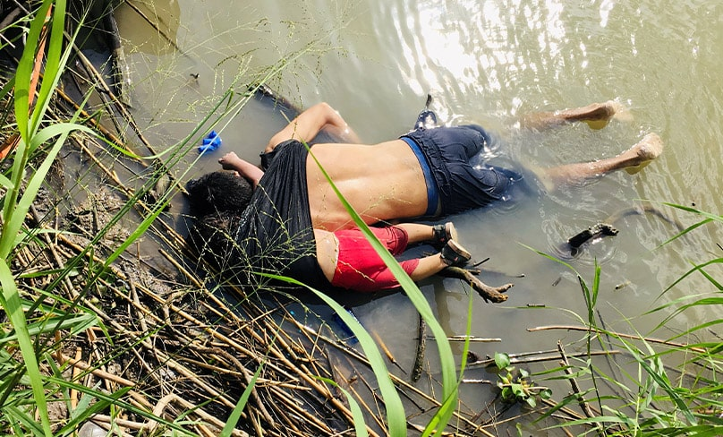 The bodies of Salvadoran migrant Oscar Alberto Martinez Ramirez and his 2-year-old daughter, Valeria, after they drowned in the Rio Grande in Matamoros, Mexico, while trying to reach the United States. Photo: CNS photo/Reuters