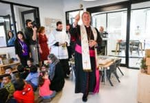 Archbishop Anthony Fisher OP blesses the new childcare centre in Sadleir. Photo: Kitty Beale