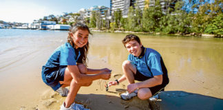 St Aloysius students Zara Timmins and Aiden Thomas test the water at Cronulla. Photo: Giovanni Portelli