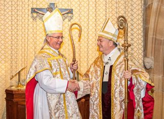 Monsignor Carl Reid greets Archbishop Anthony Fisher OP at his installation in St Mary's Cathedral on 27 August. Photo: Alphonsus Fok
