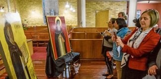Staff and students view the new icons for Santa Sabina College in Strathfield. Photo: Brian Walker