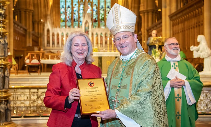Bishop Randazzo presents catechist Teyona van Stom with an award for 50 years of service. Photo: Giovanni Portelli