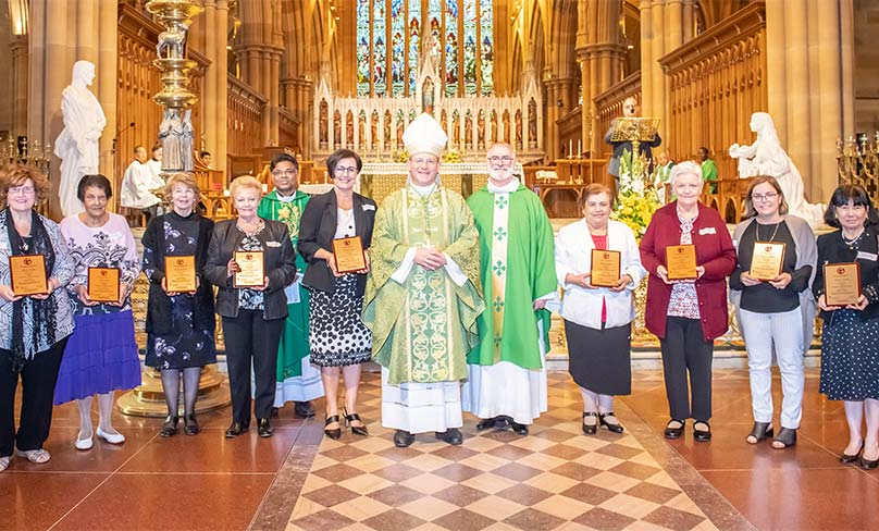 Bishop Randazzo with some of the 100 catechists who were presented with awards for their many years of service. Photo: Giovanni Portelli