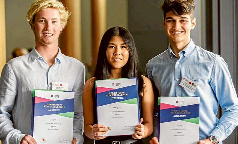 Seamus Connon, left, Christabel Chang and Robert Ciccarelli proudly display their First in HSC course certificates on Monday. Photo: Giovanni Portelli