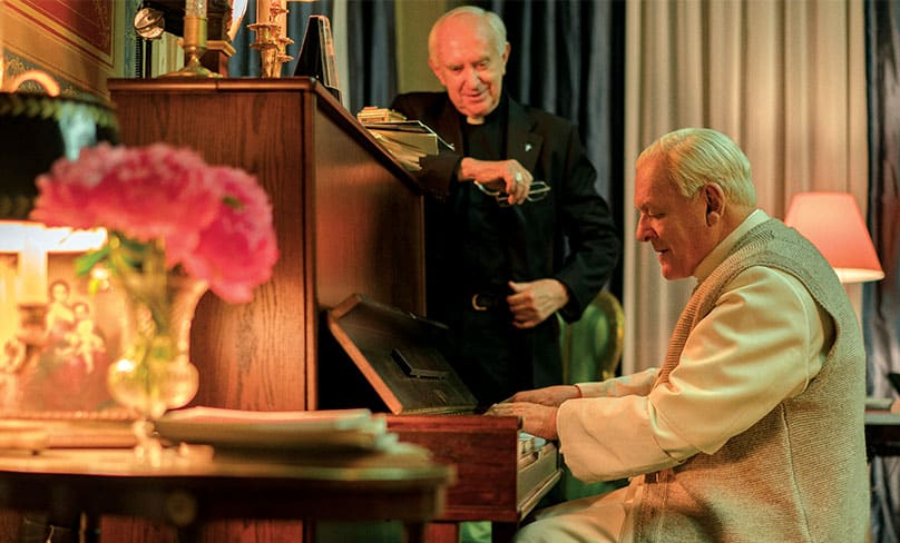 Pope Benedict XVI (Anthony Hopkins) sparks a moment of reflection for Cardinal Bergoglio (Jonathon Pryce) as he showcases his piano prowess. Photo: Peter Mountain, NETFLIX