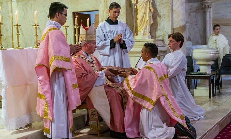 Noel Custodio is ordained to the Deaconate by Auxiliary Bishop Richard Umbers. Photo: Patrick Lee