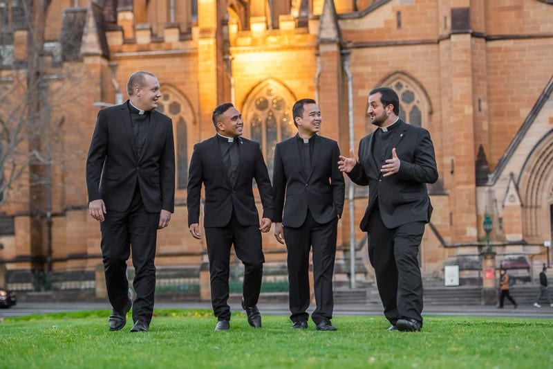 Deacons Jonathan Vala, Noel Custodio, John Pham and Roberto Keryakos will soon be ordained to the priesthood at St Mary's Cathedral on 19 September. Photo: Giovanni Portelli