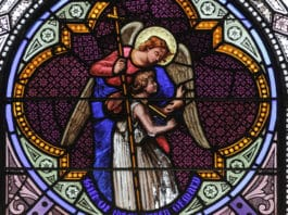 A guardian angel is depicted i stained glass window in St Joseph's church in Greenwich Village, NYC. Photo: Lawrence OP/Flickr, CC BY-NC-ND 2.0
