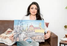 Syriac Catholic artist Ghusoon Durdur with her painting depicting the invasion of her parish by ISIS in Northern Iraq. Photo: Giovanni Portelli