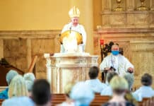 Bishop Terry Brady preaches at the 100th anniversary Mass at St Brigid's in Coogee. Photo: Giovanni Portelli